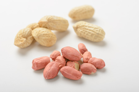 36930843 - peanuts on the white background.